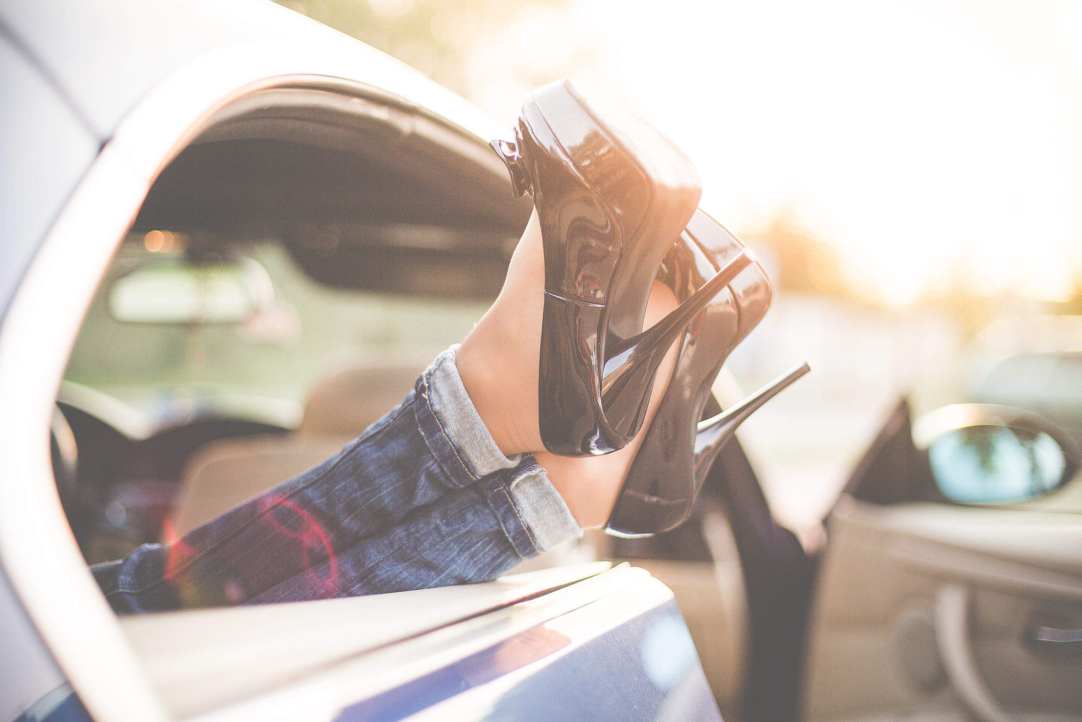 Sexy Woman Legs on High Heels Out of Car Windows Free Stock Photo