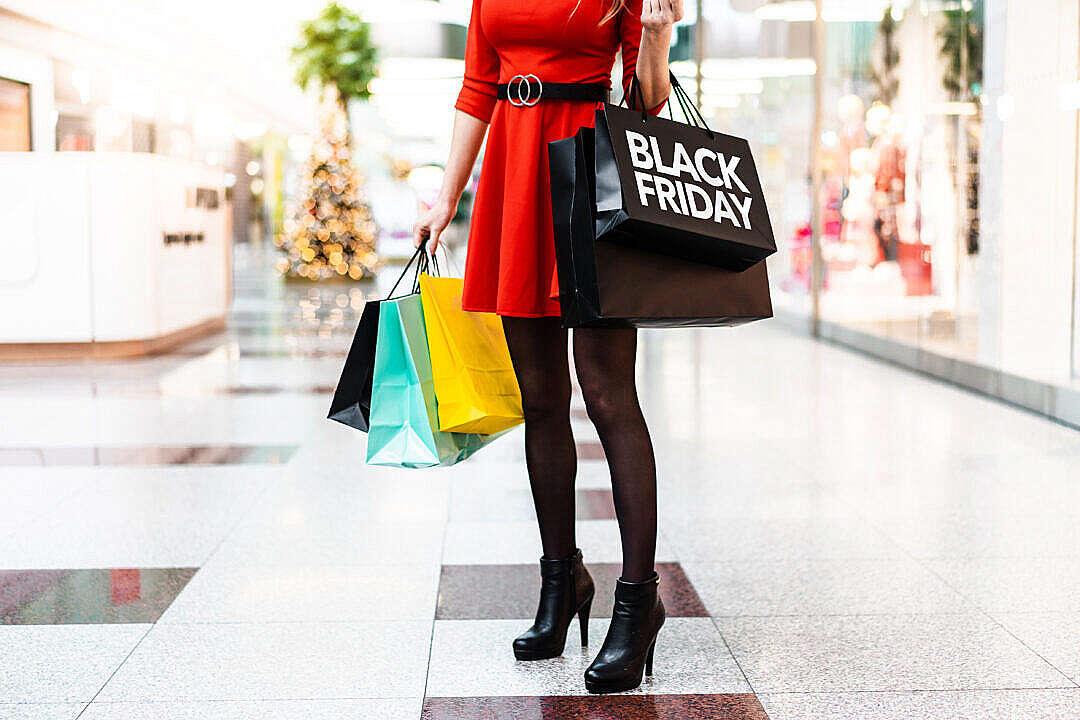 Download Shopaholic Woman with BLACK FRIDAY Shopping Bags FREE Stock Photo
