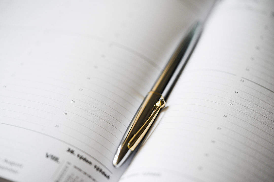 Download Silver Pen in Open Business Day Planner Diary FREE Stock Photo