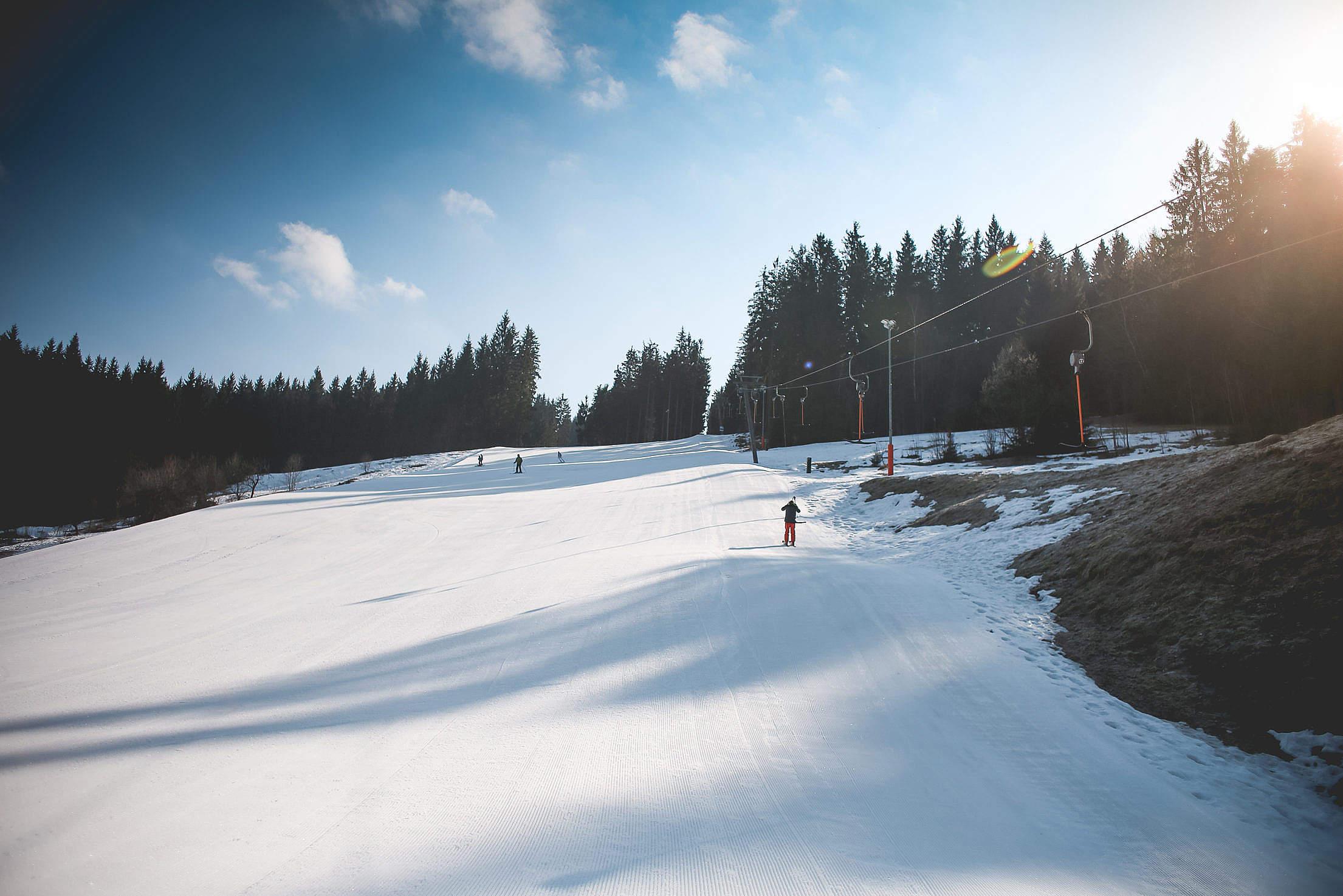 Ski Slope with Sunny Weather Free Stock Photo