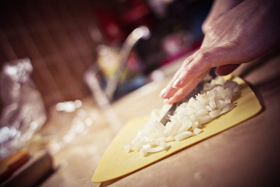 Download Slicing Onions in the Kitchen FREE Stock Photo