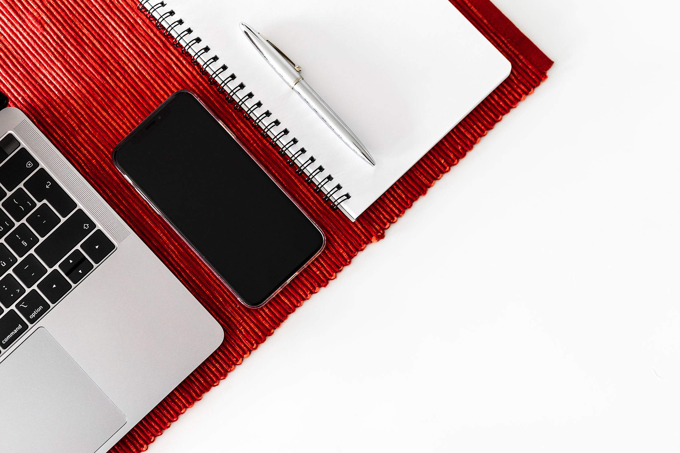 Smartphone, Laptop and Diary on White Table Free Stock Photo