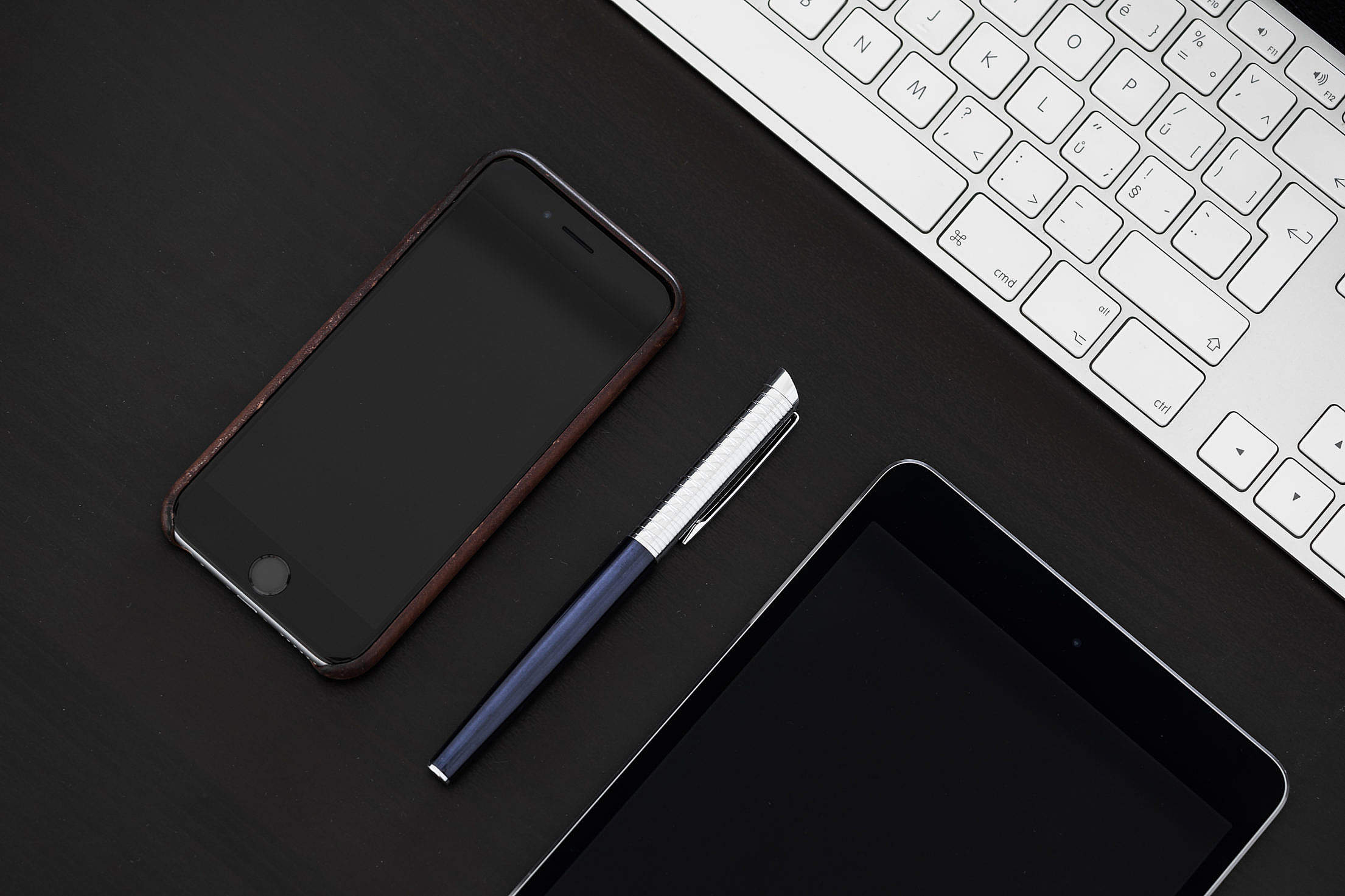 Smartphone with Pen on Office Desk From Above Free Stock Photo