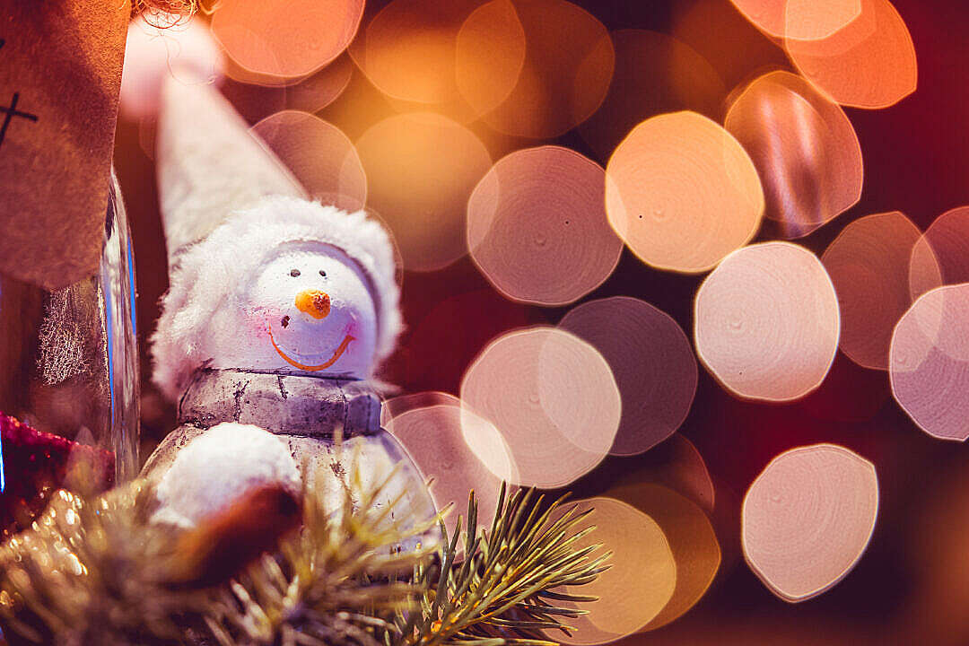 Download Snowman Decoration with Christmas Bokeh FREE Stock Photo