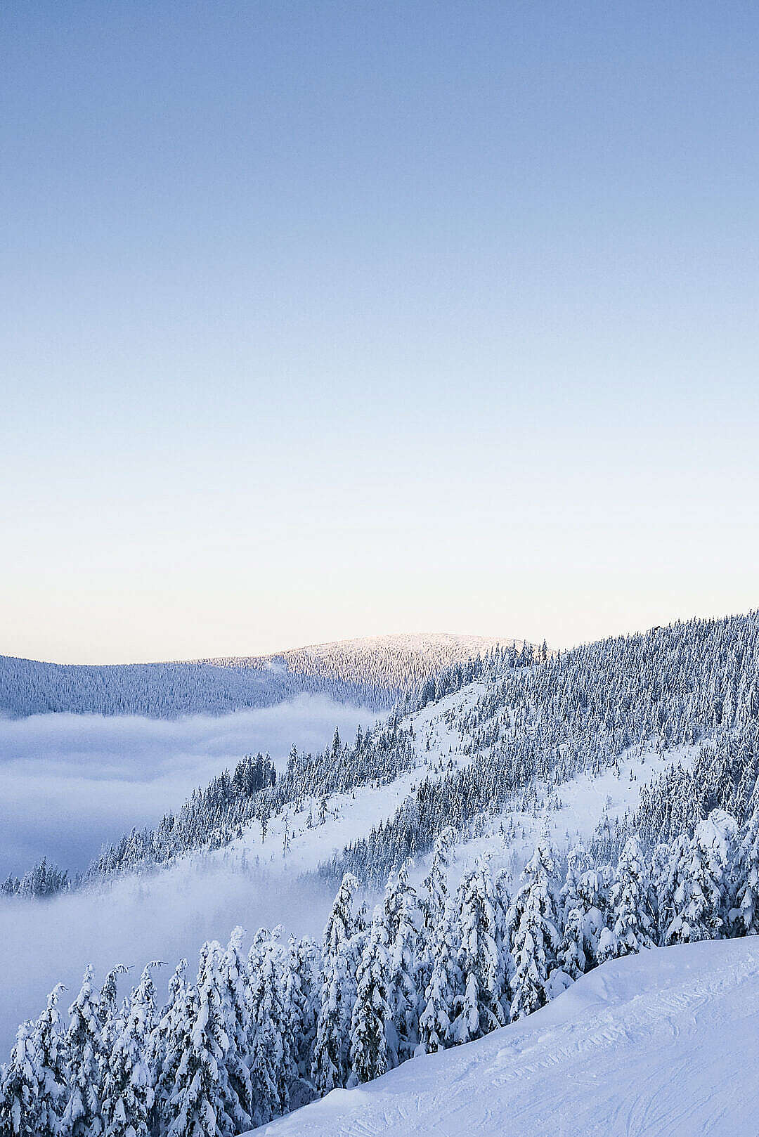 Download Snowy Hills with Cloudless Sky FREE Stock Photo