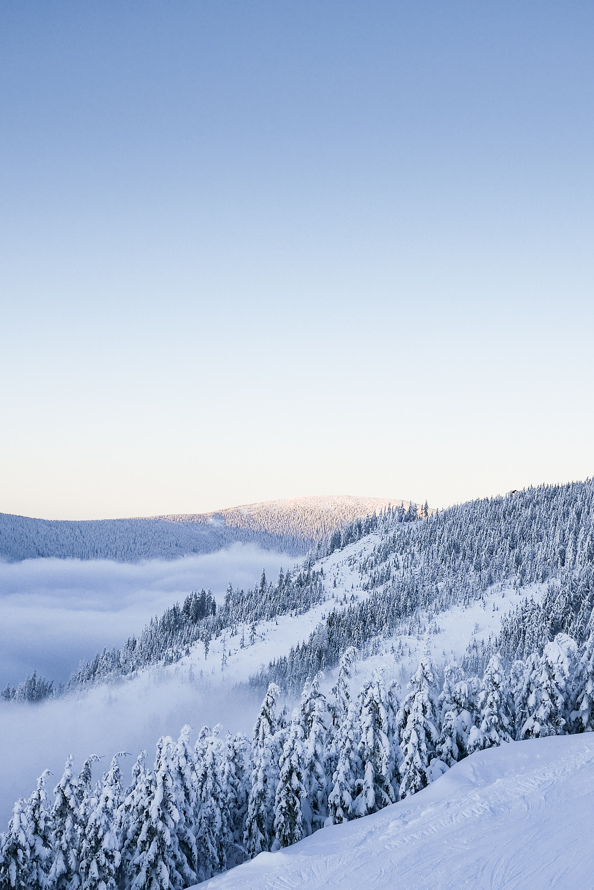 Snowy Hills with Cloudless Sky Free Stock Photo