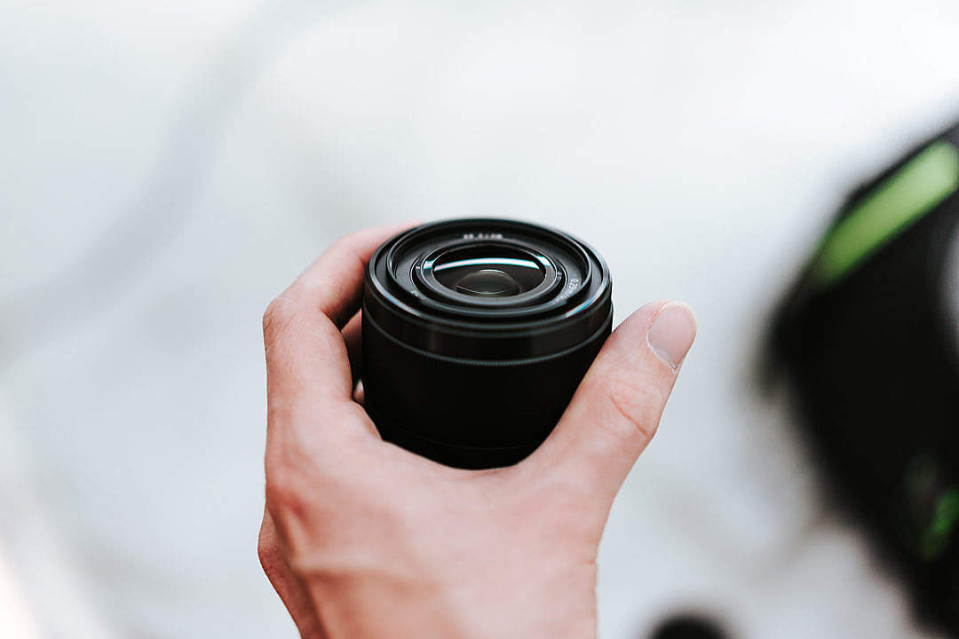 Download Sony 28mm f2 Lens in Hand FREE Stock Photo