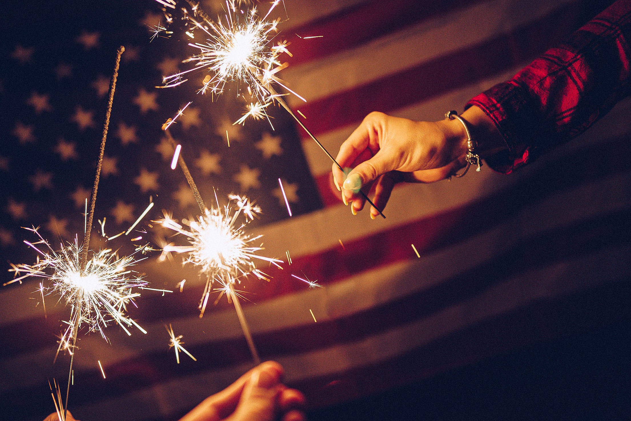Sparklers and USA Flag Free Stock Photo