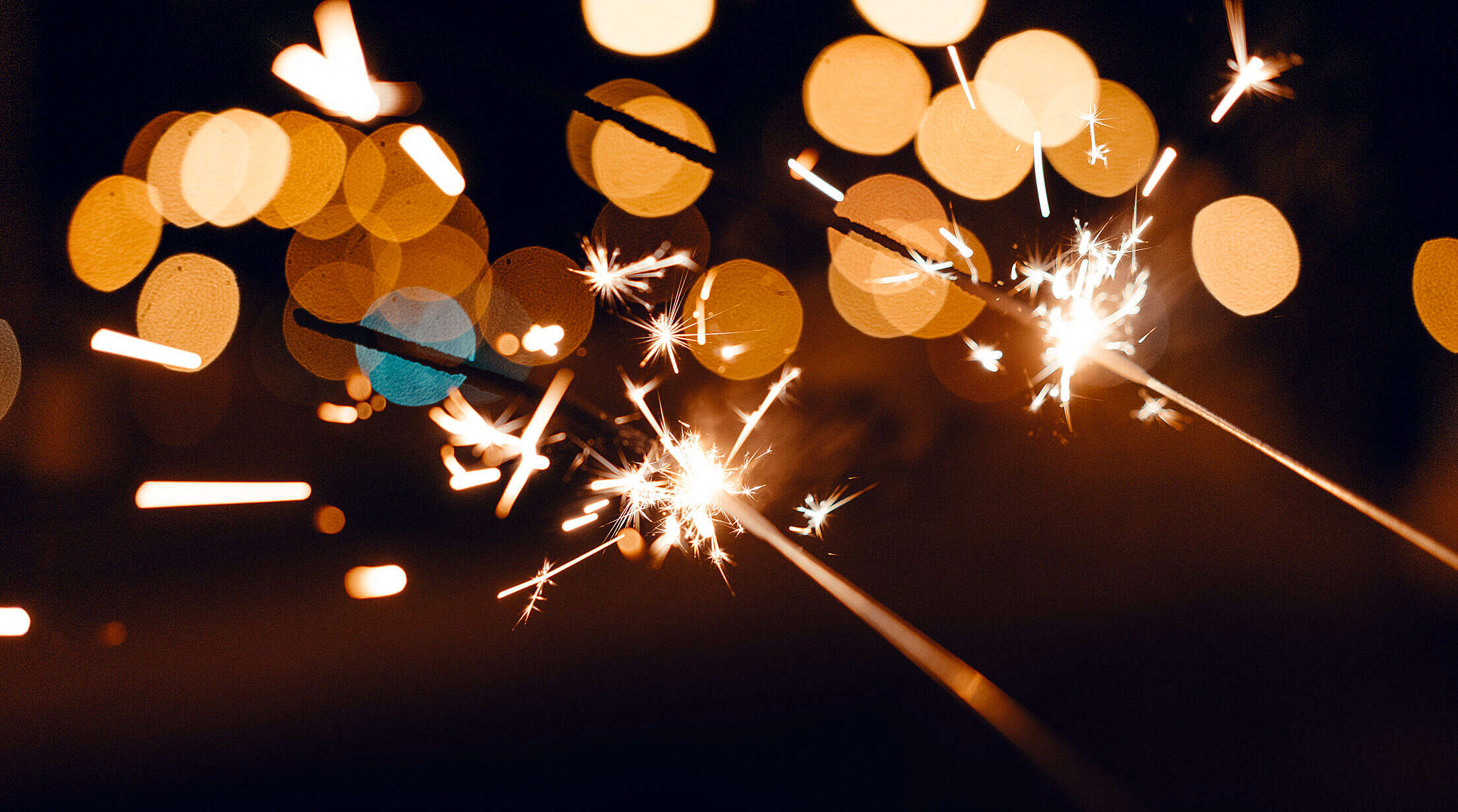 Sparklers with Beautiful Abstract Bokeh Free Stock Photo