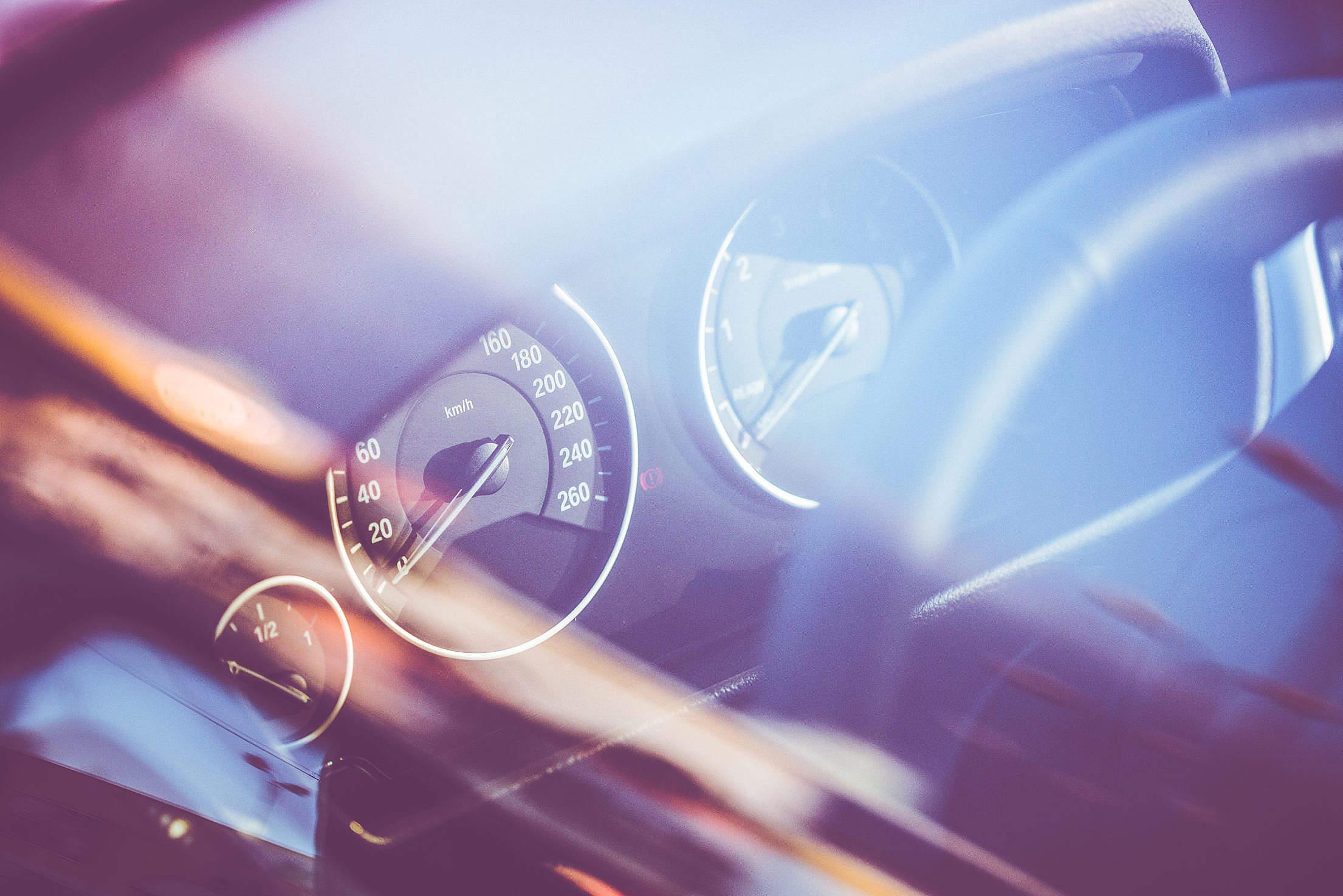 Speed-O-Meter in a Car Through Window Free Stock Photo