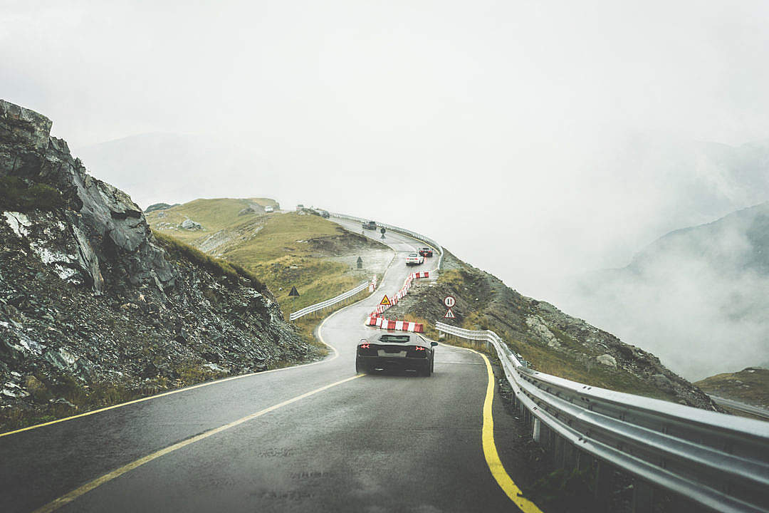 Download Sport Cars on Wet Mountain Road in Rainy Weather FREE Stock Photo