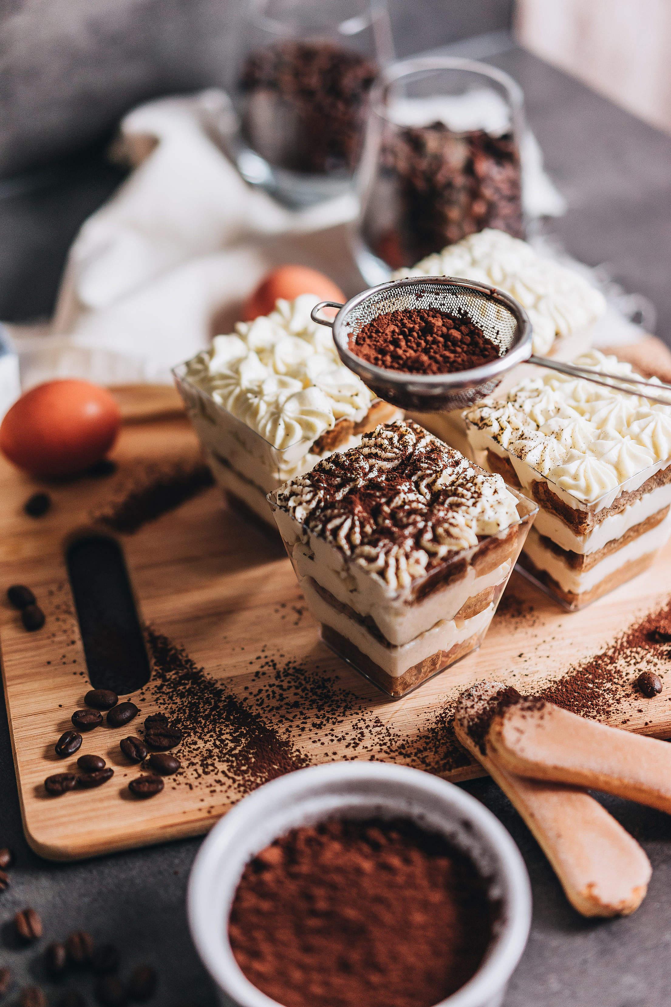 Sprinkling Cocoa Powder on Tiramisu Trifles Free Stock Photo