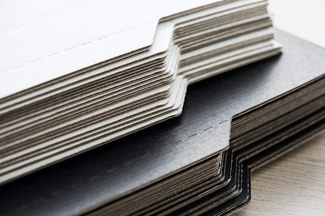 Download Stack of Paper Cardboard in Print-Shop FREE Stock Photo