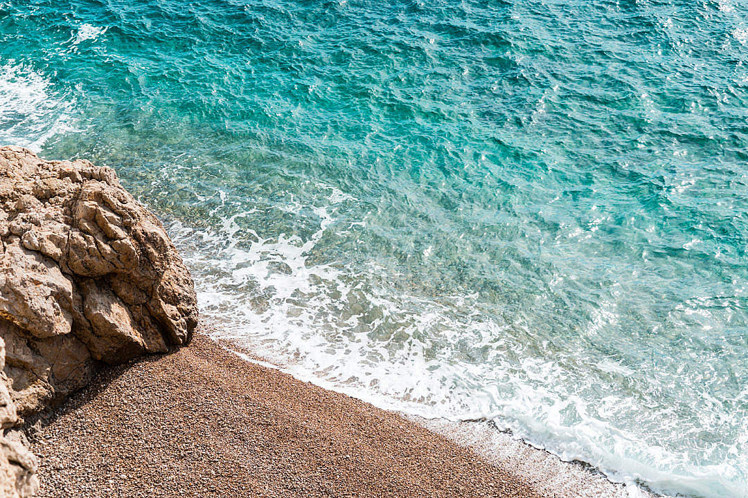 Download Stone Beach and Blue Sea FREE Stock Photo