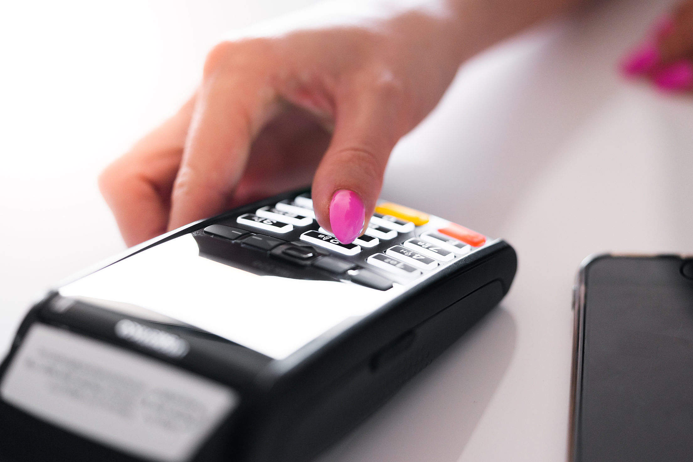 Store Manager Using Credit Card Reader Free Stock Photo