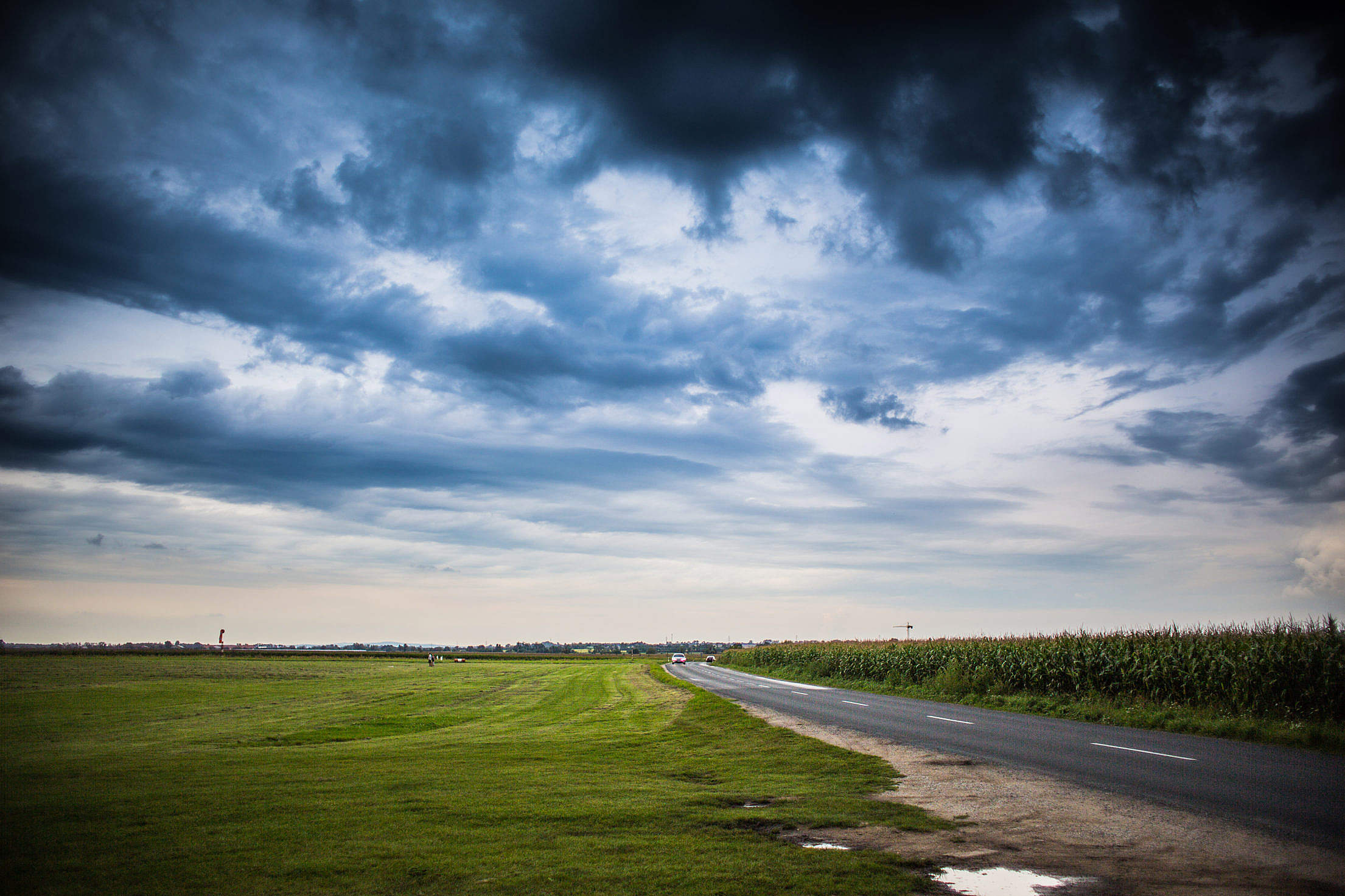 Storm Clouds Over The Road Free Stock Photo