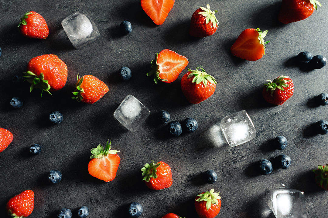 Download Strawberries and Blueberries Flat Lay on a Dark Background FREE Stock Photo