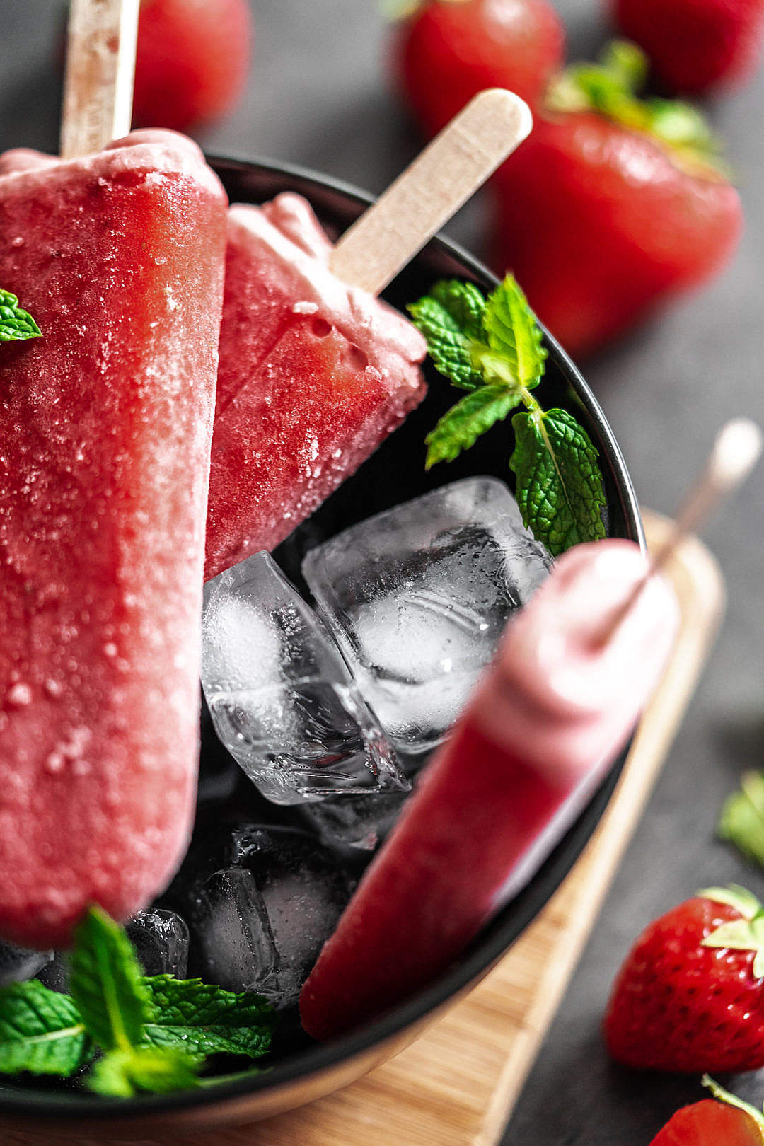 Download Strawberry Ice Lollies in a Black Bowl FREE Stock Photo