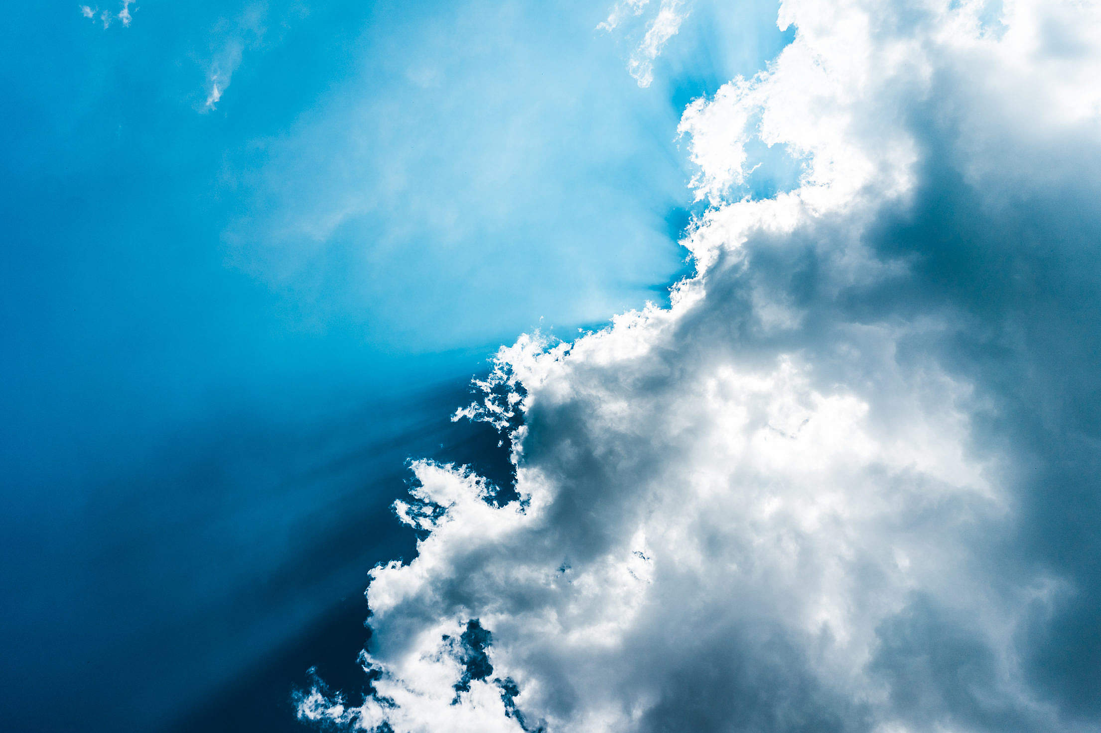 Sun Behind Clouds Free Stock Photo