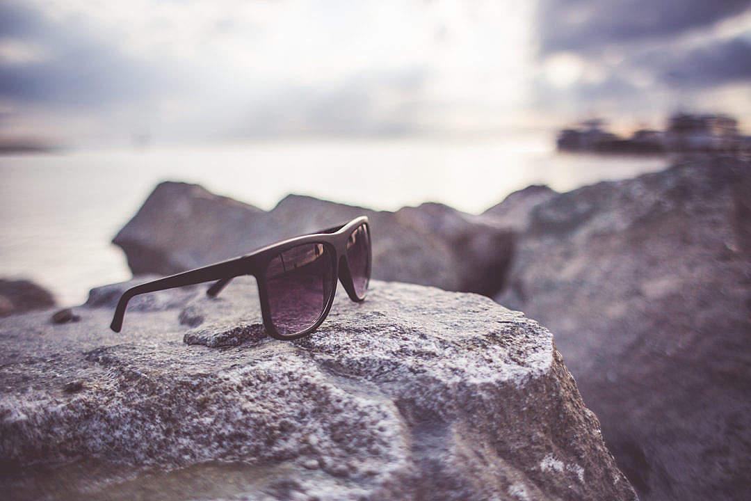Download Sunglasses on a Rock FREE Stock Photo