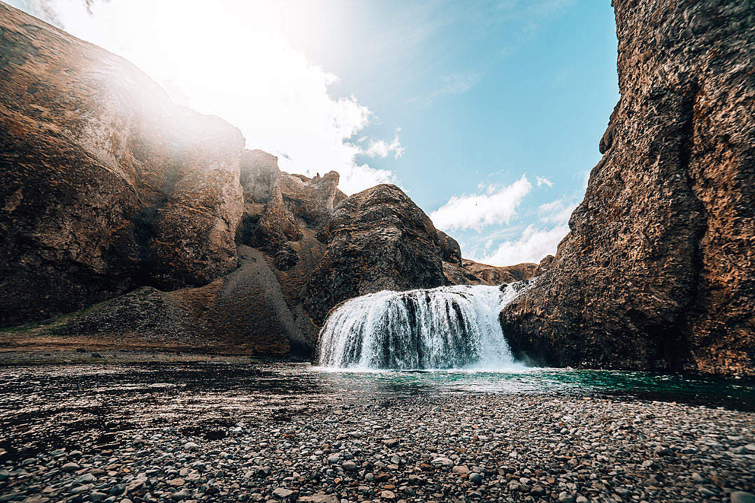Download Sunrise at a Waterfall in Iceland FREE Stock Photo