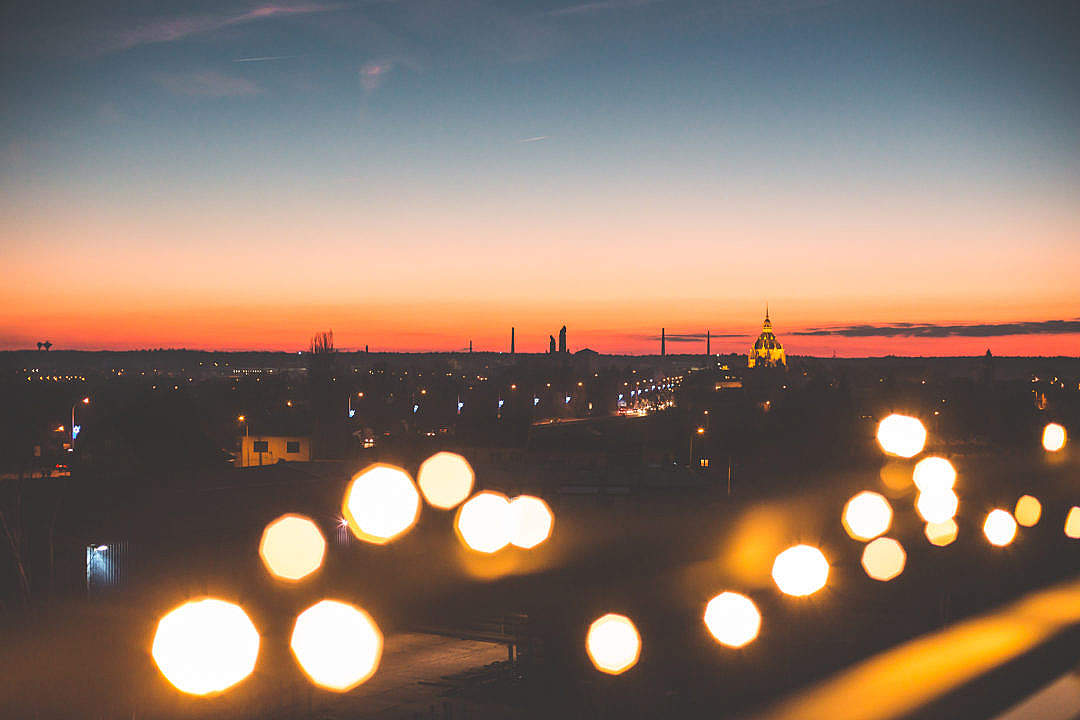 Download Sunset Cityscape with Bokeh Lights FREE Stock Photo