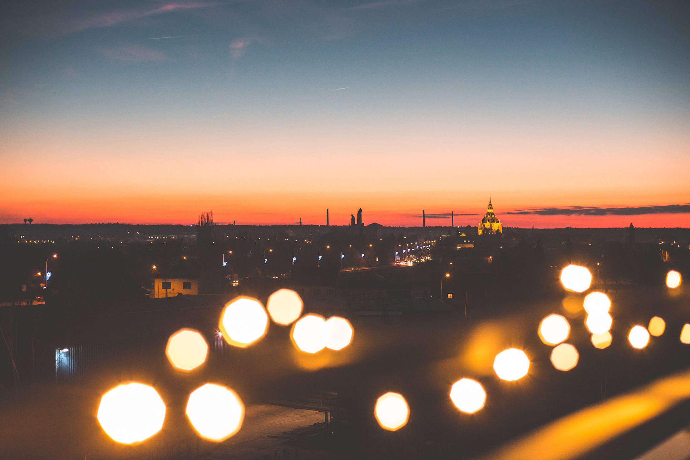 Sunset Cityscape with Bokeh Lights Free Stock Photo