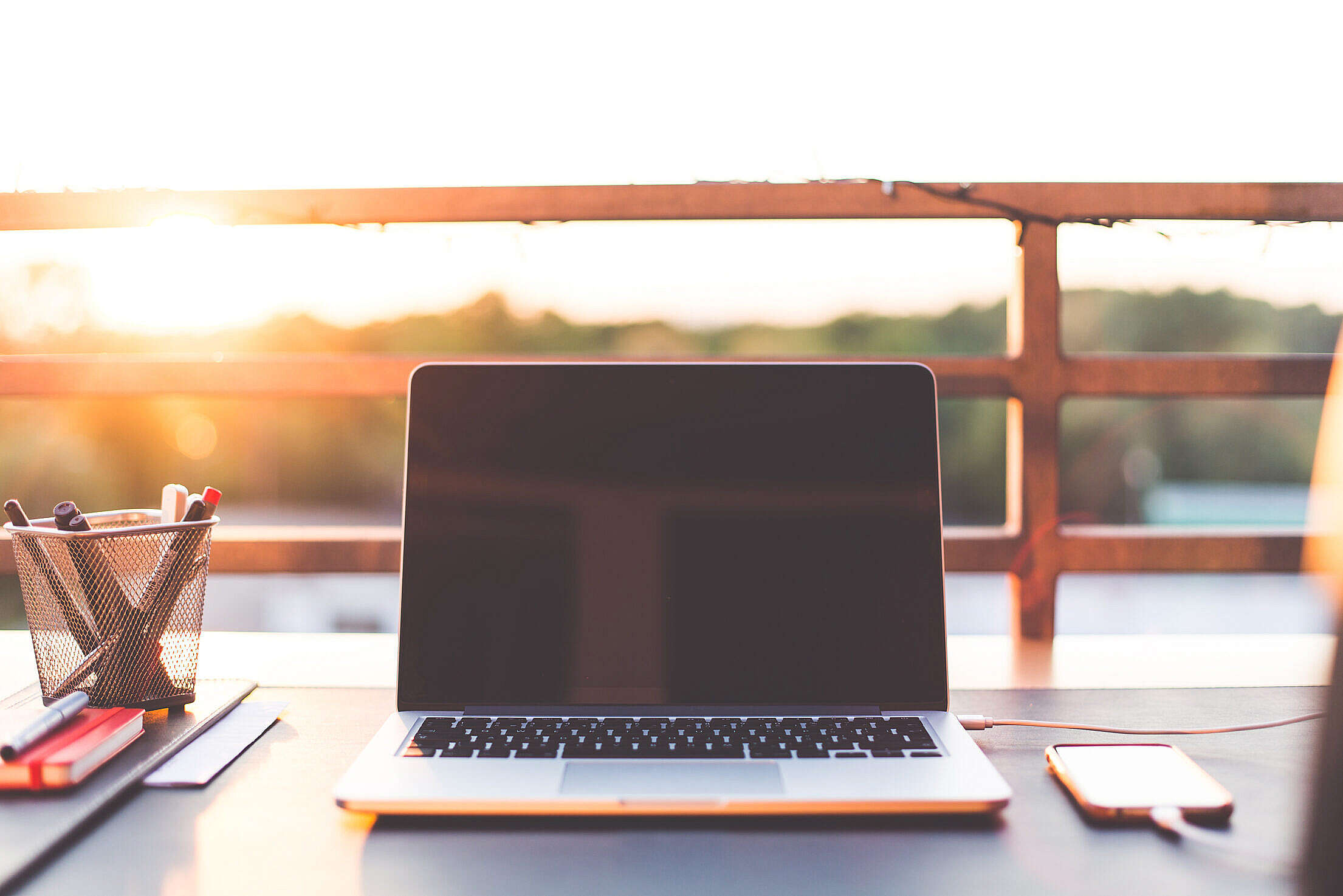 Sunset Home Office Working with Laptop on the Garden Free Stock Photo