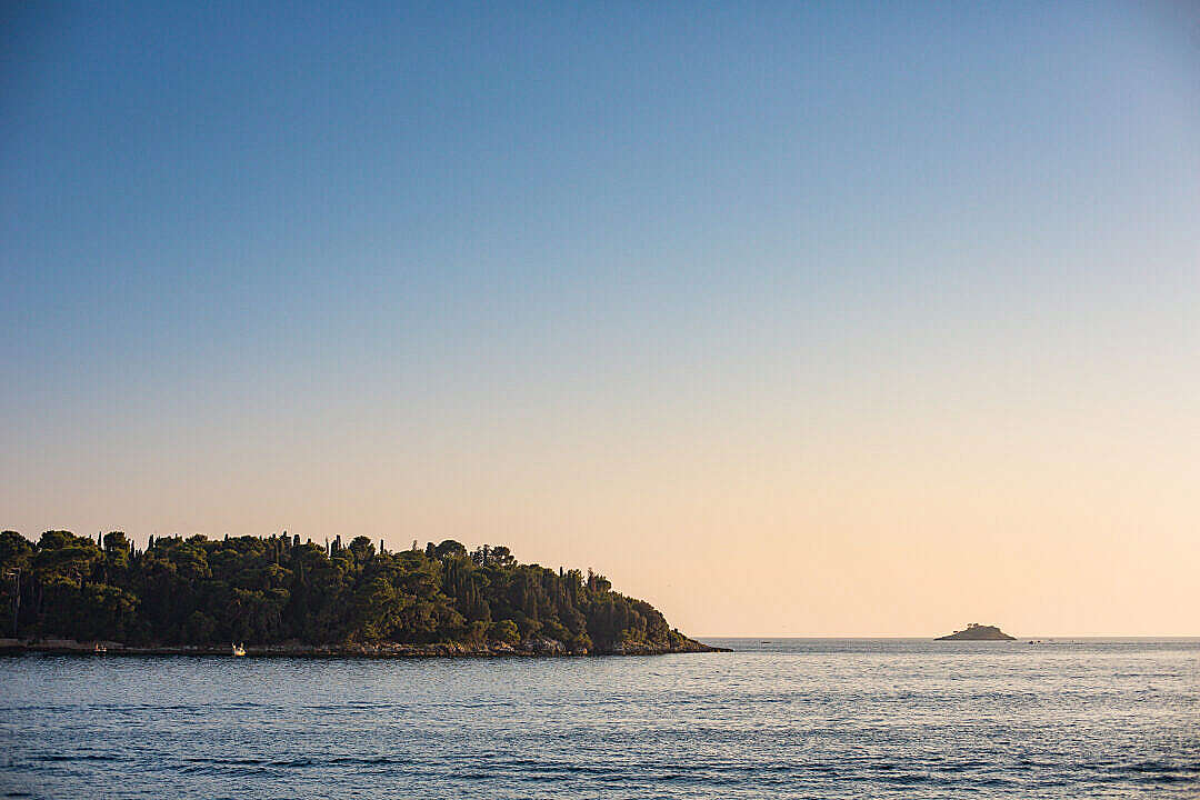 Download Sunset over a Small Island in Croatia FREE Stock Photo