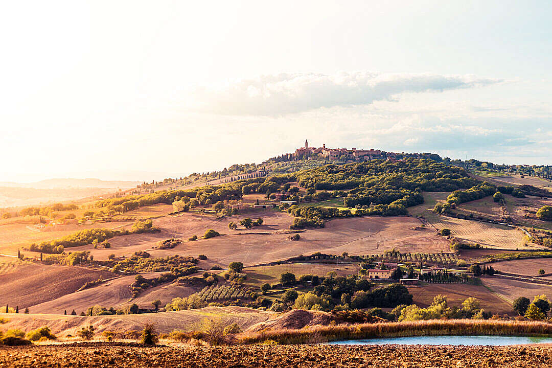 Download Sunset Over the Pienza Town in Tuscany (Val d'Orcia), Italy FREE Stock Photo
