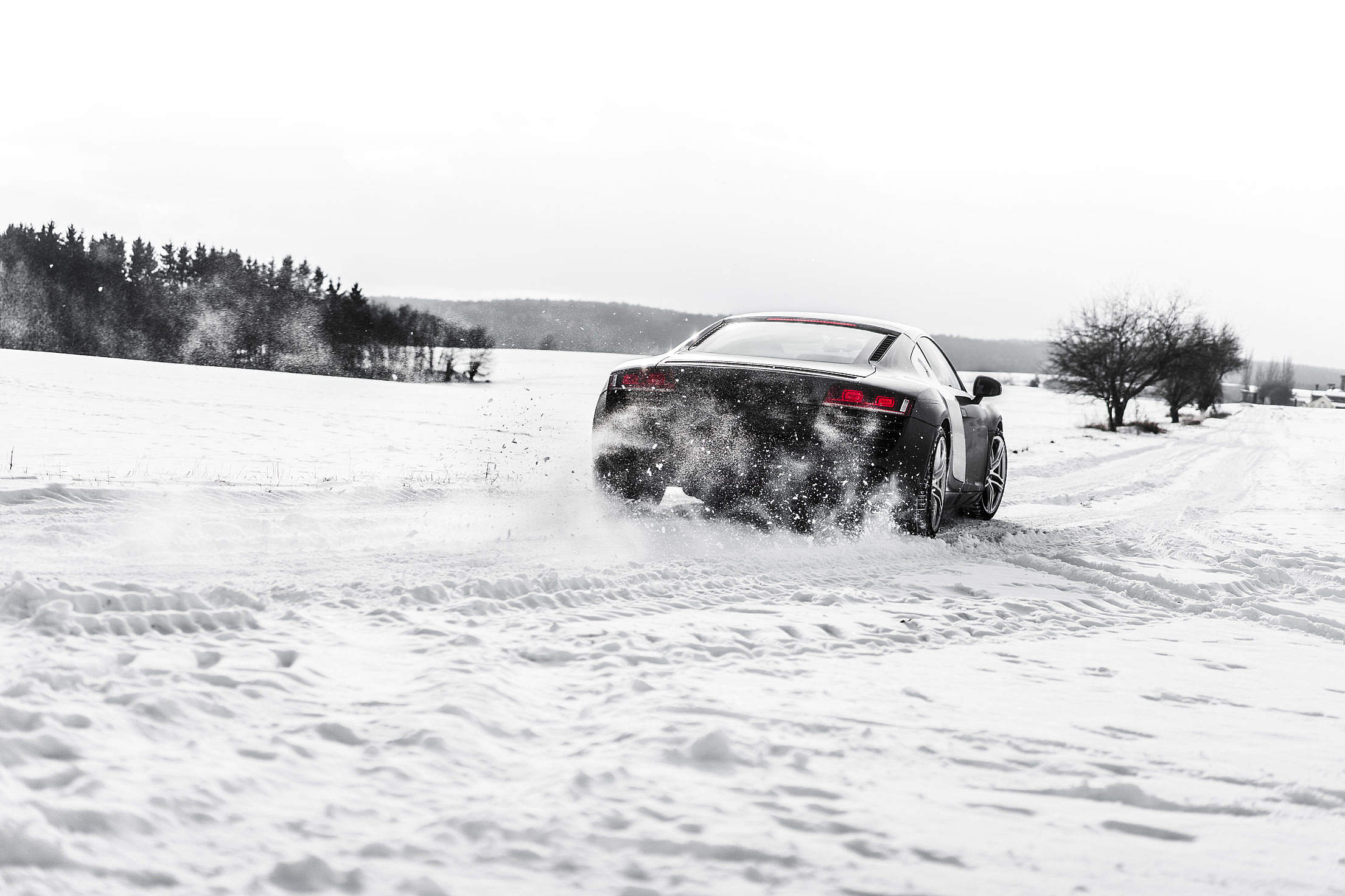 Supercar Drifting on a Snow Covered Road Free Stock Photo