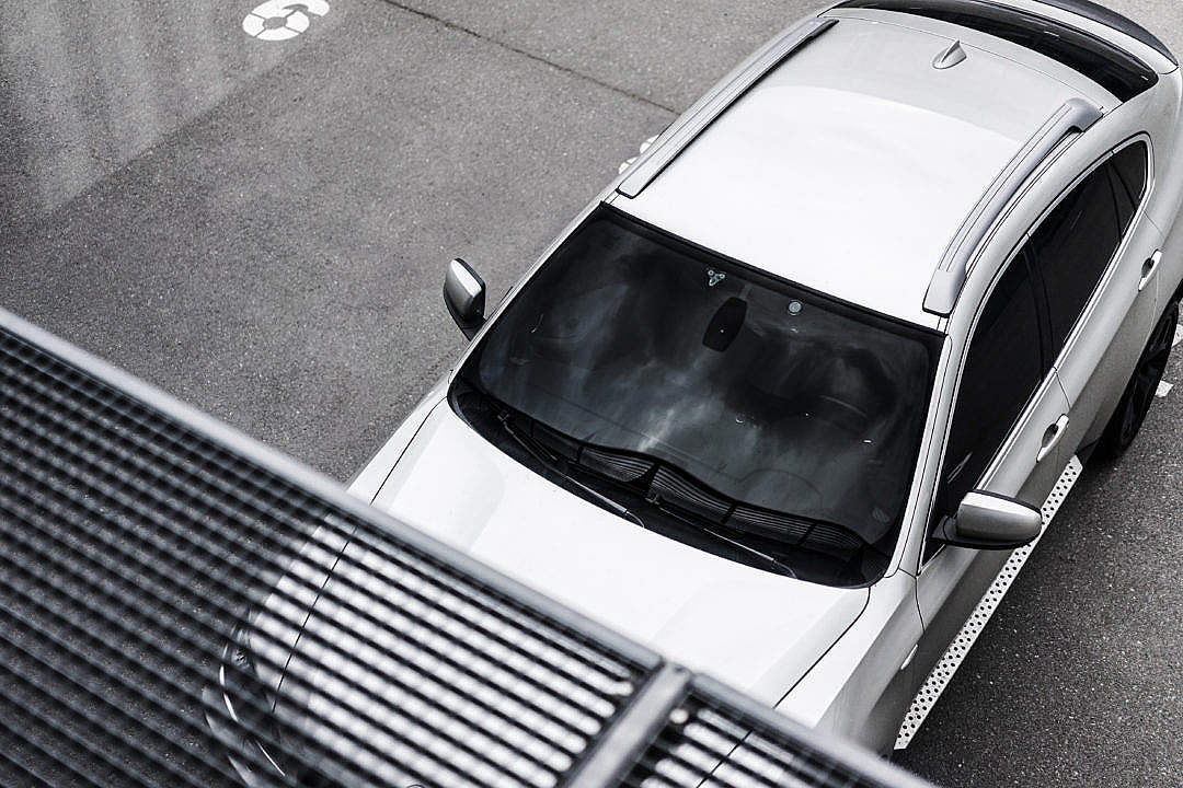 Download SUV Car Parked in Front of a Building FREE Stock Photo