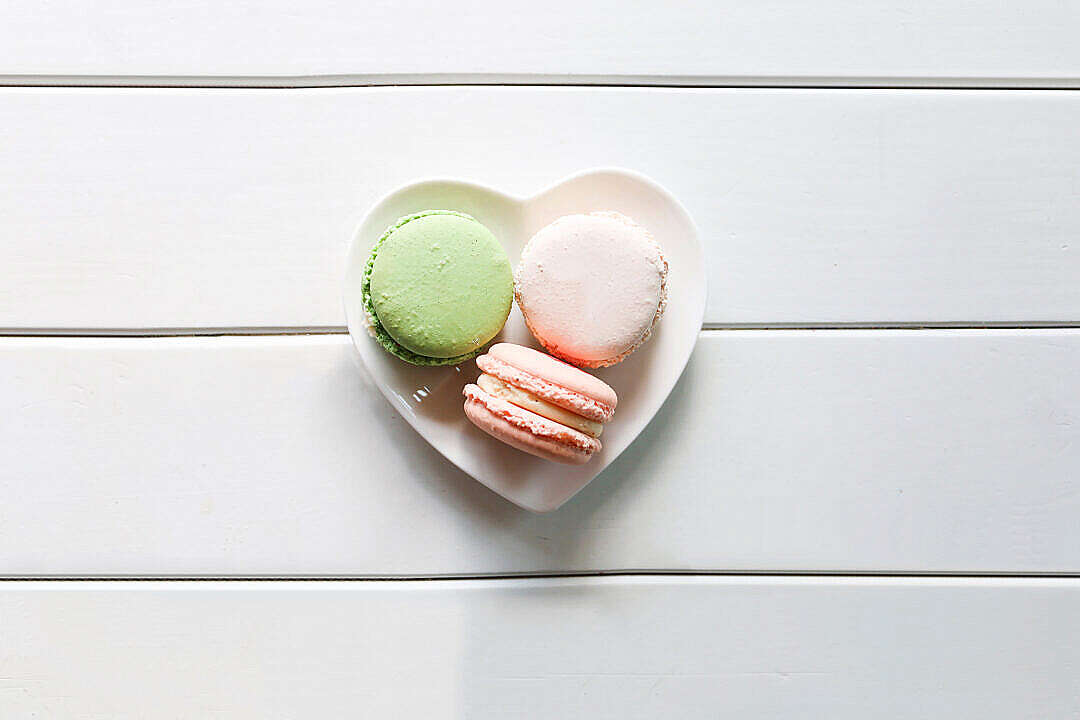 Download Sweet Macarons on a Heart-Shaped Plate FREE Stock Photo