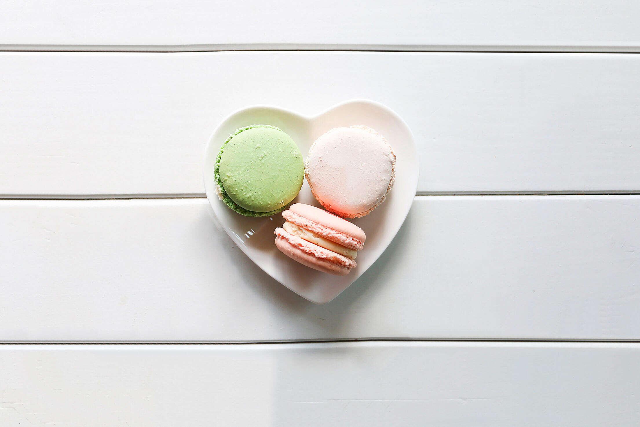 Sweet Macarons on a Heart-Shaped Plate Free Stock Photo