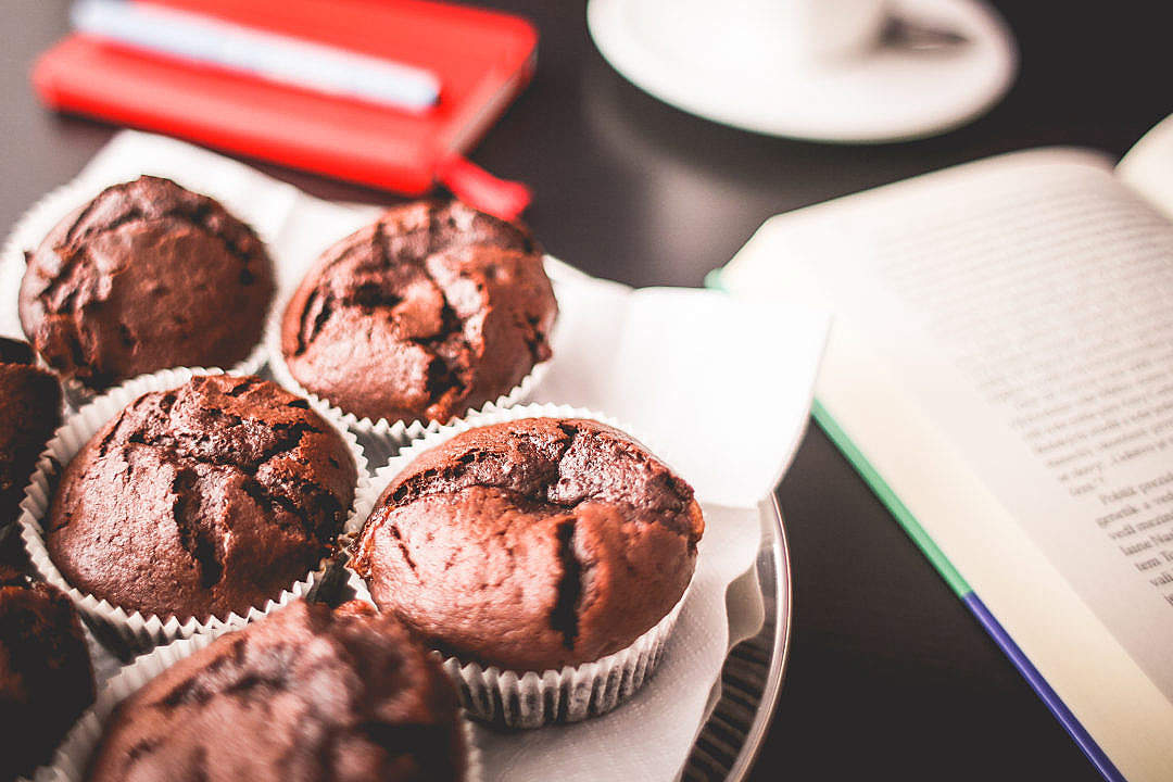Download Sweet Muffins with A Book FREE Stock Photo