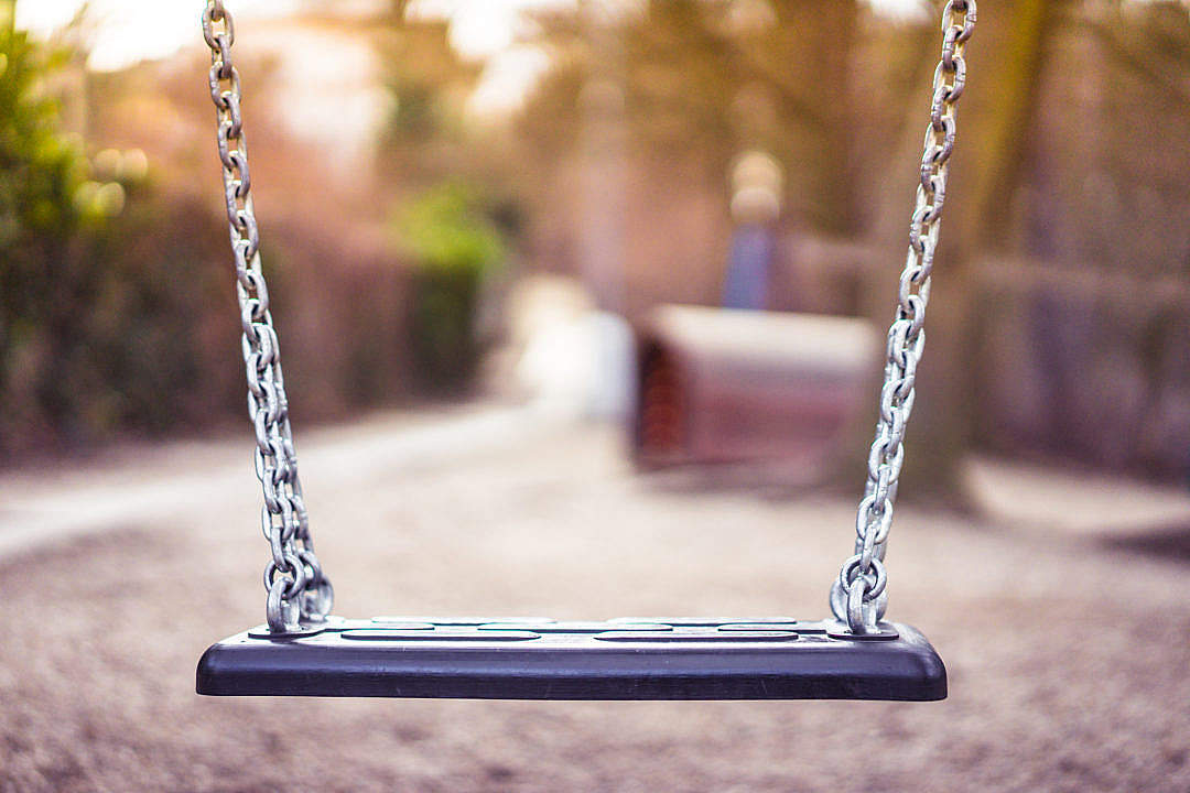 Download Swing For Kids in City Park Playground FREE Stock Photo