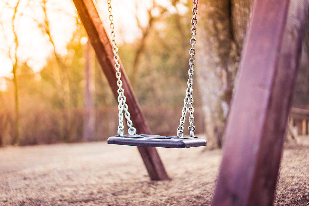 Download Swing For Kids in City Park Playground #2 FREE Stock Photo