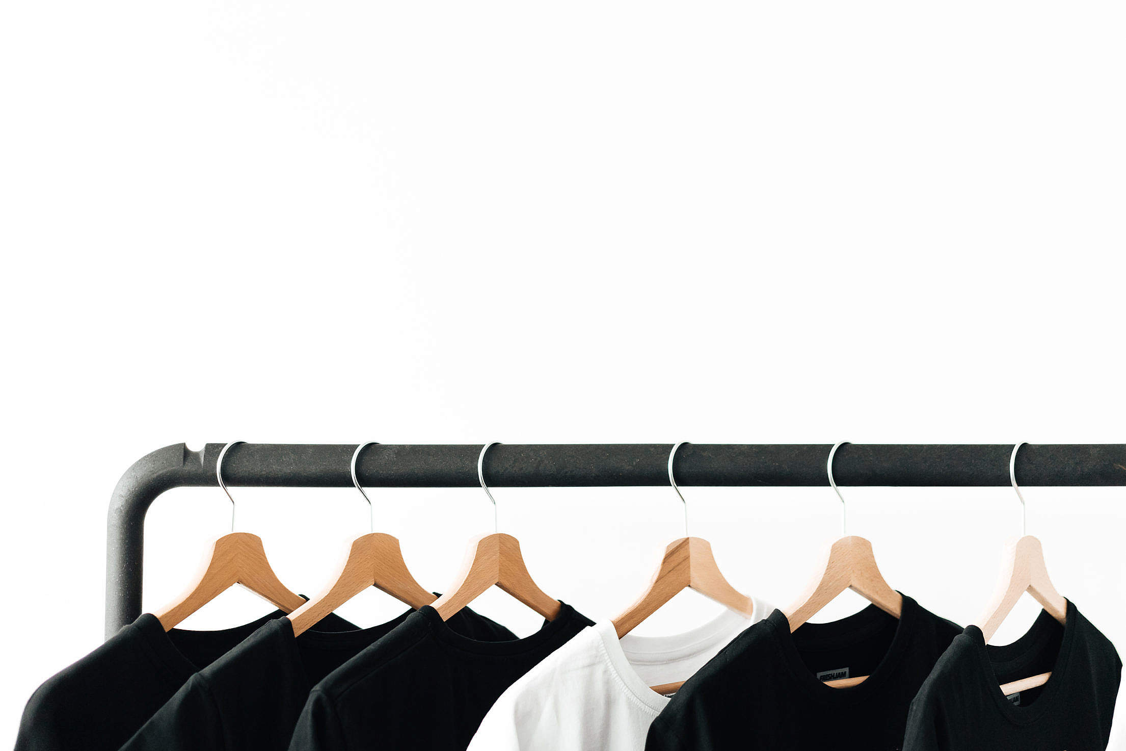 T-Shirts on Rack with Room for Text Free Stock Photo