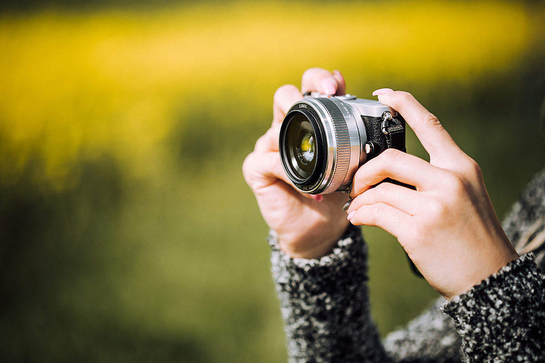 Download Taking a Photo with Small Mirrorless Camera FREE Stock Photo