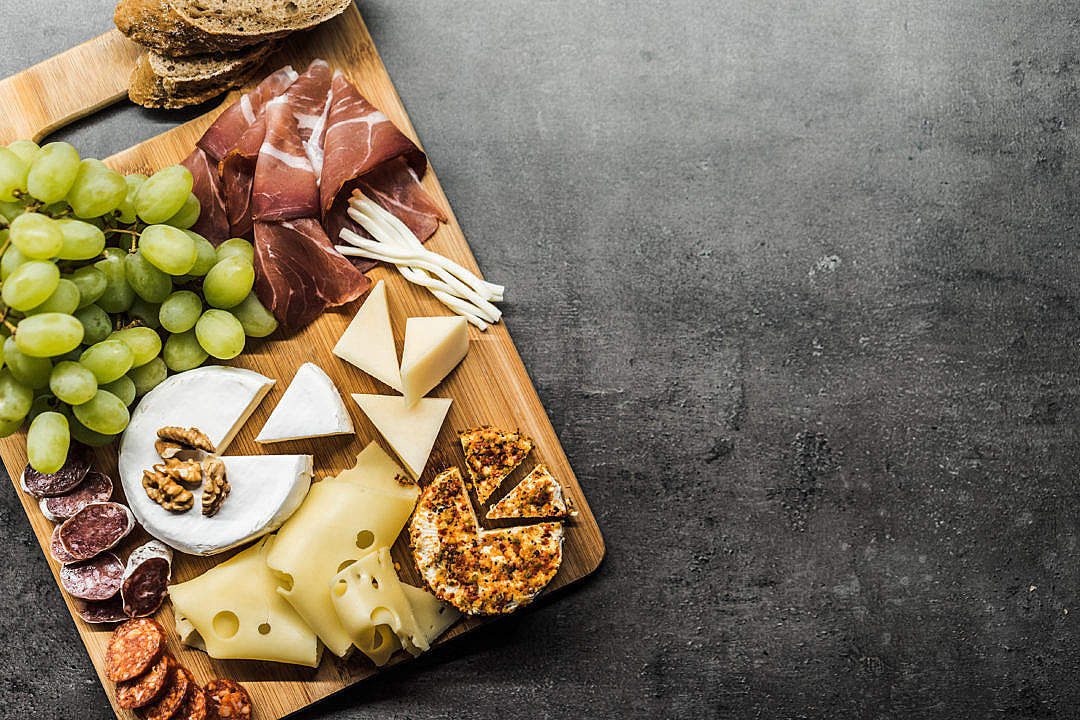 Download Tasting Cheese Dish on a Wooden Plate FREE Stock Photo
