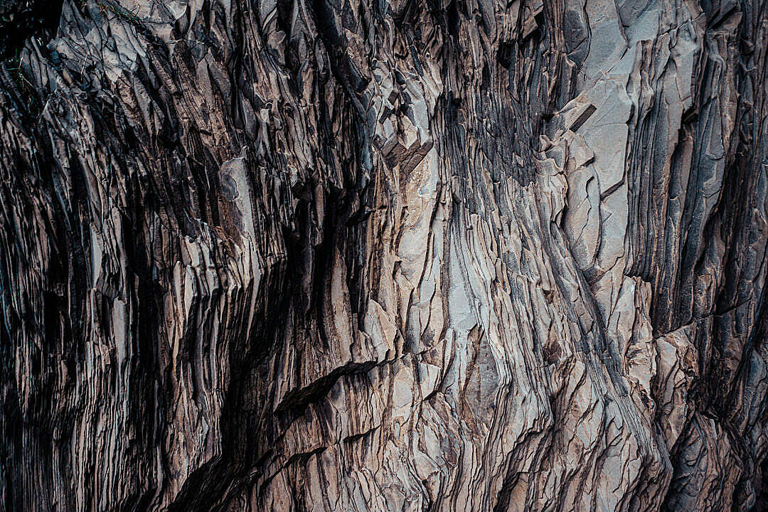 Download Texture of a Layered Dark Rock FREE Stock Photo