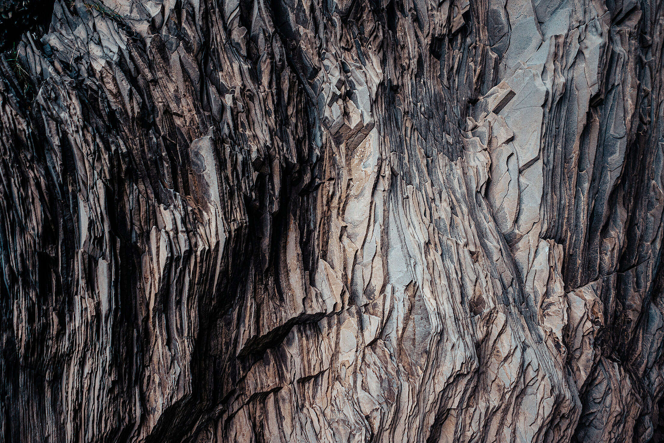 Texture of a Layered Dark Rock Free Stock Photo