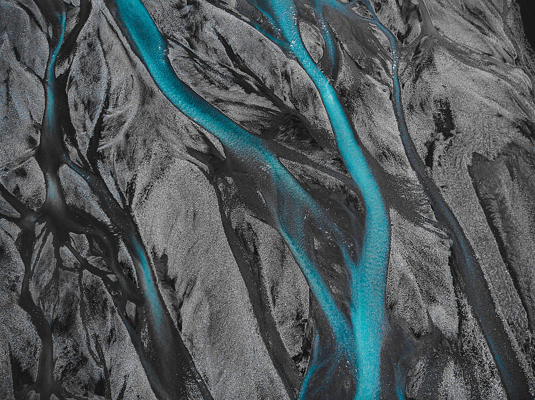 Download Texture of an Icelandic River in a Black Sand FREE Stock Photo
