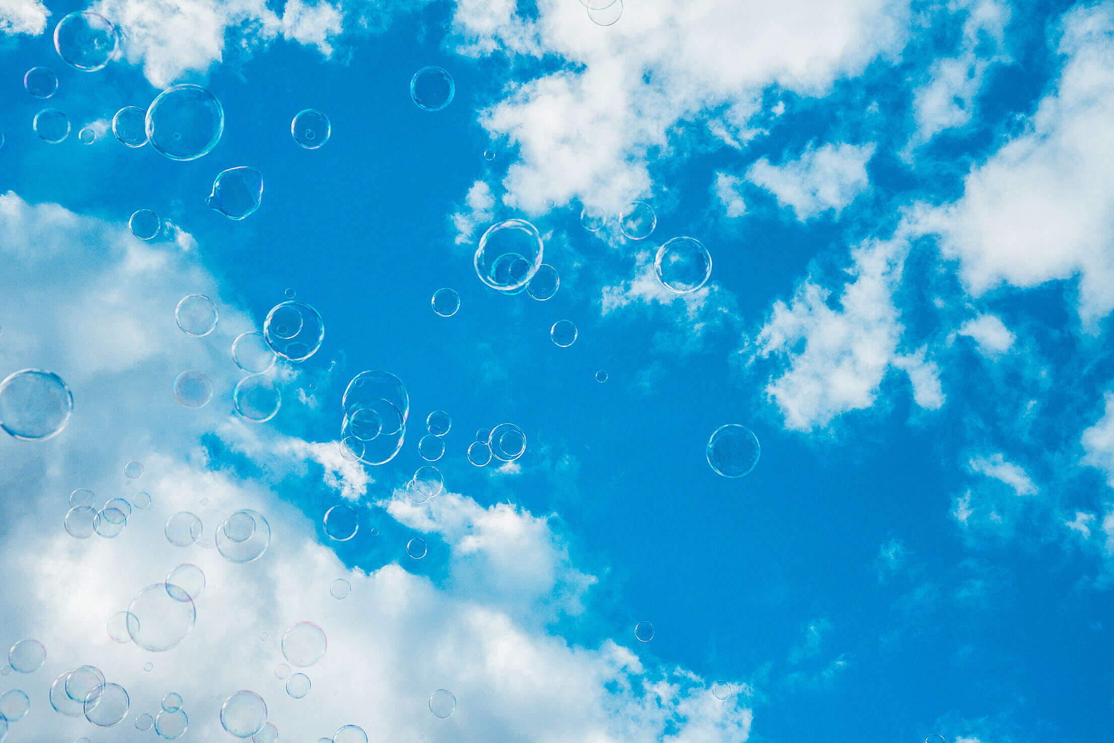 Thousands of Bubbles Against Bright Blue Sky Free Stock Photo