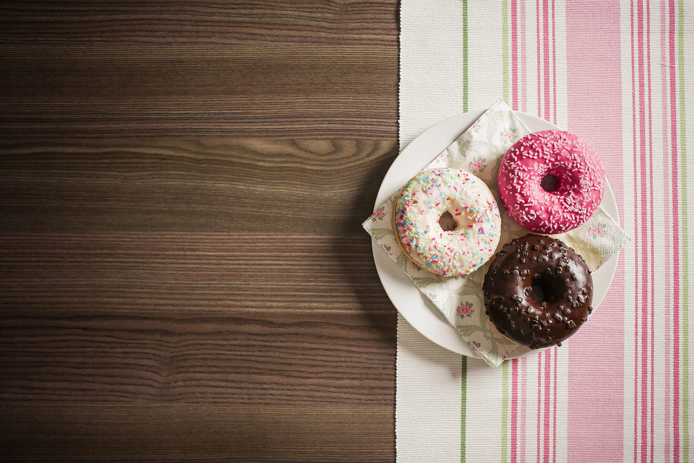 Three Yummy Donuts with Room for Text Free Stock Photo