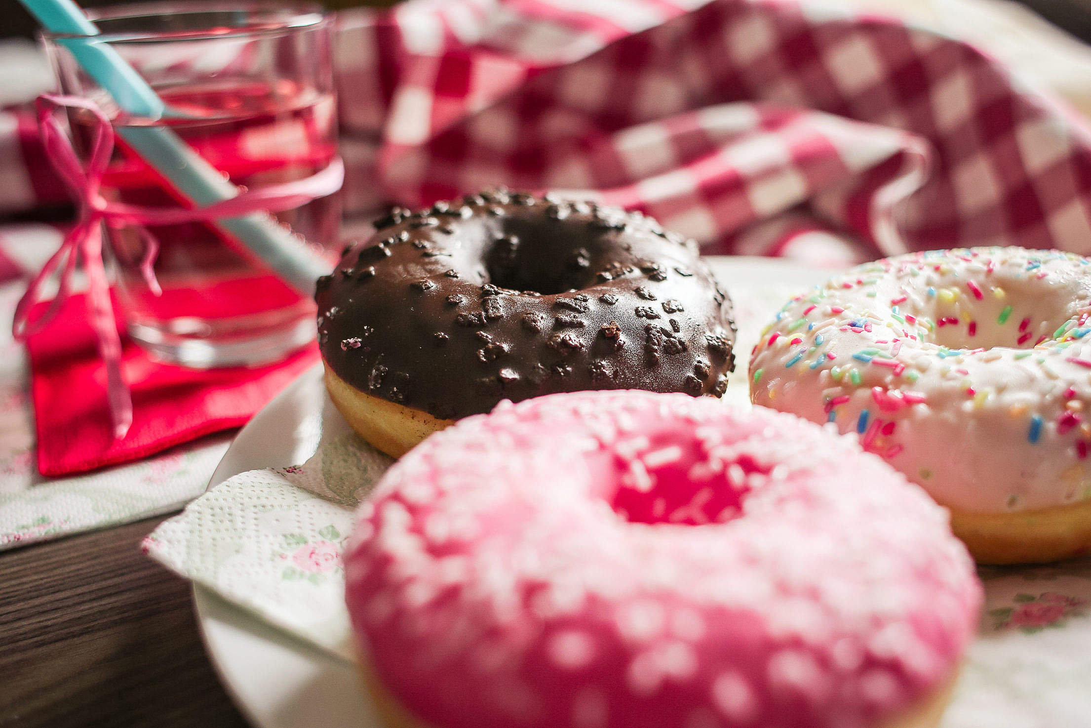 Three Yummy Sweet Colorful Donuts Free Stock Photo