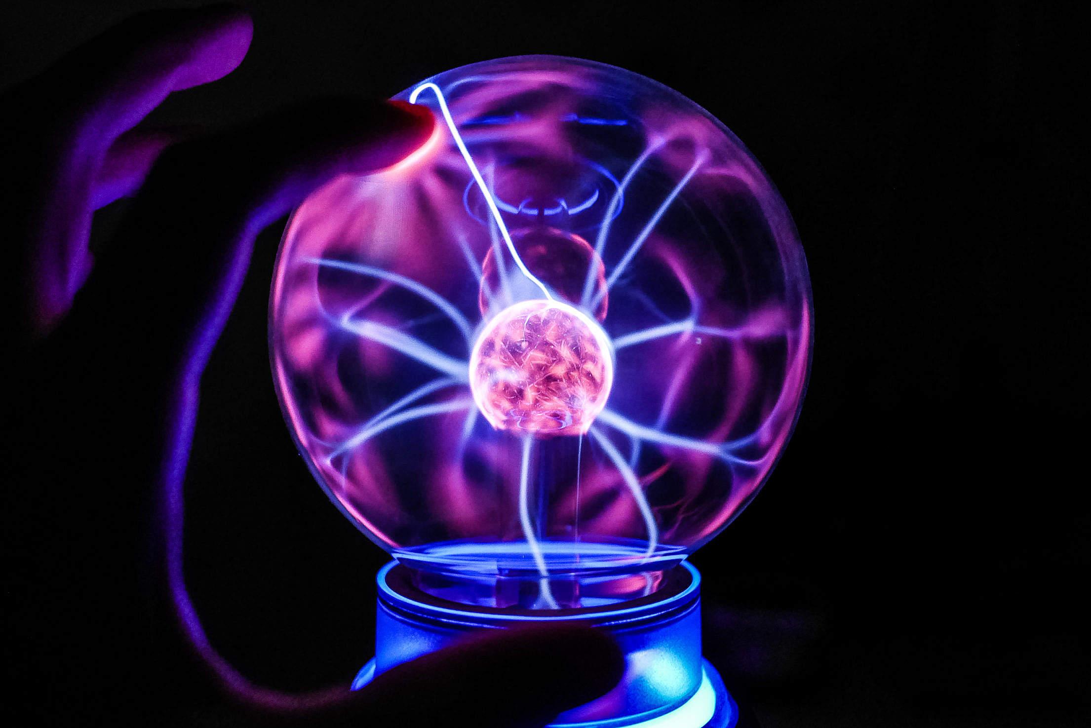 Touching The Plasma Ball Lamp Free Stock Photo