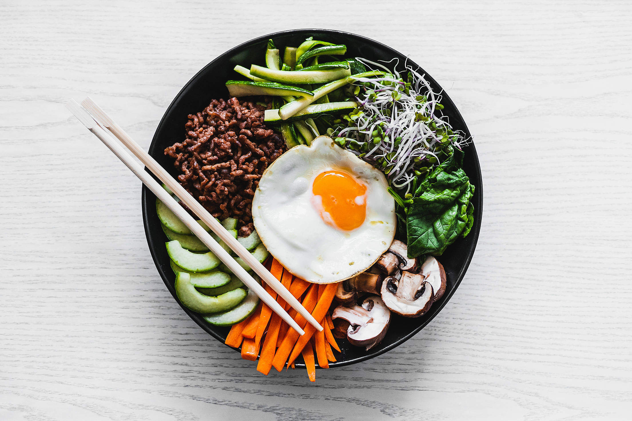 Traditional Korean Bibimbap in a Bowl Free Stock Photo
