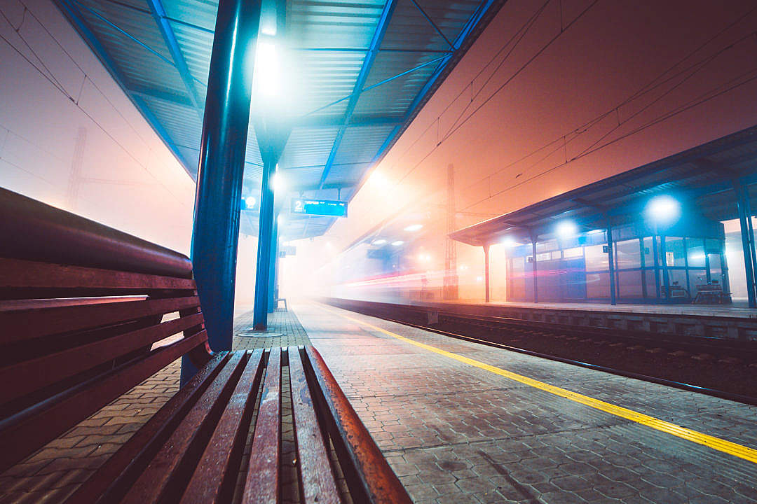 Download Train Leaving Railway Station in Foggy Night FREE Stock Photo