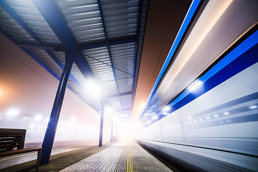 Download Train Leaving The Railway Station At Night FREE Stock Photo